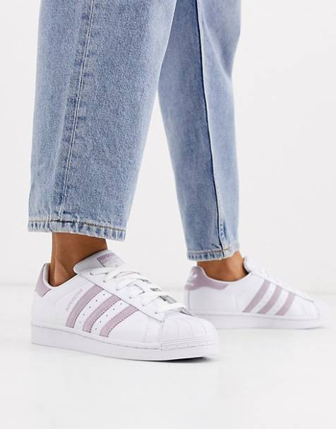 adidas Originals Superstar sneakers in white and lilac