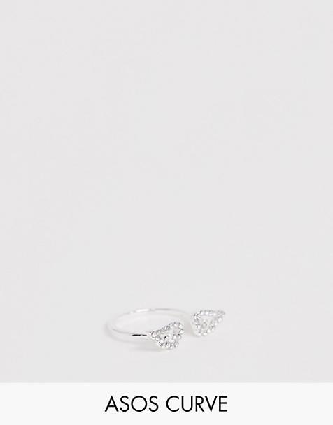 c07965f44aa2 Anillo plateado con alas de ángel de cristal de ASOS DESIGN Curve