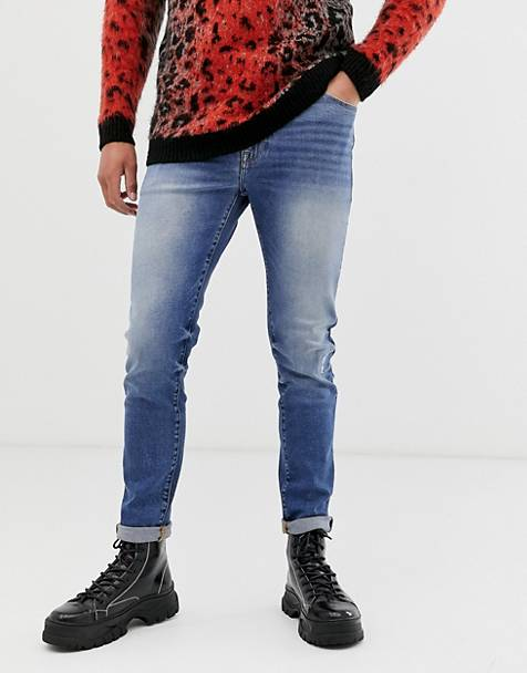 ASOS DESIGN 12.5oz skinny jeans in mid wash blue with abrasions and bum rip