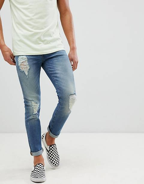 ASOS DESIGN 12.5oz skinny jeans in mid wash blue with heavy rips