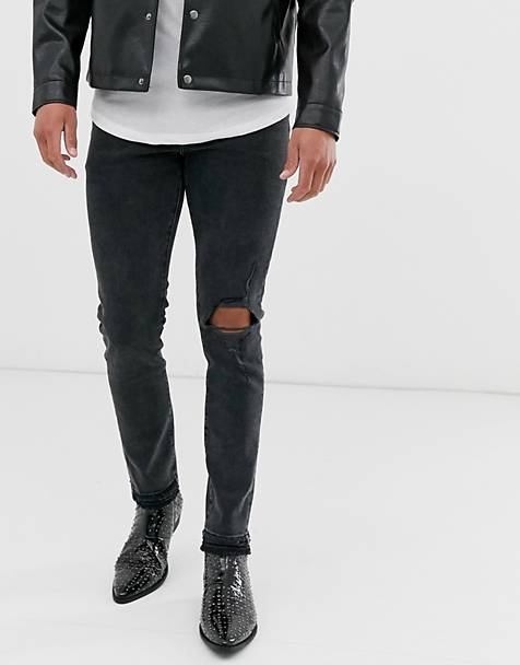 ASOS DESIGN 12.5oz skinny jeans in washed black with knee rip and destroyed hem