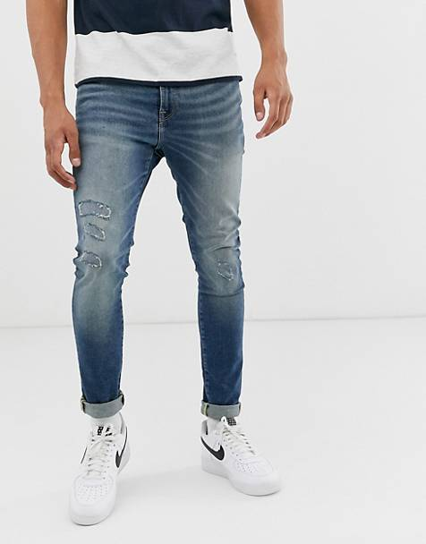 ASOS DESIGN 12.5oz super skinny jeans in smokey washed blue with rip and repair