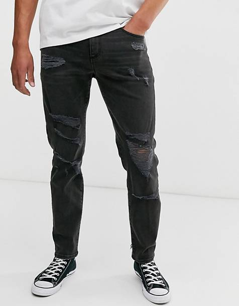 ASOS DESIGN 12.5oz tapered jeans in washed black with heavy rips