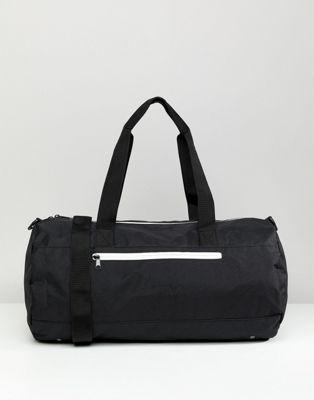 Image 1 of ASOS DESIGN barrel bag in black with white zips