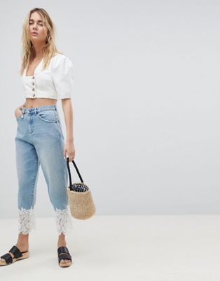 ASOS DESIGN boyfriend jeans in mid wash with lace hem