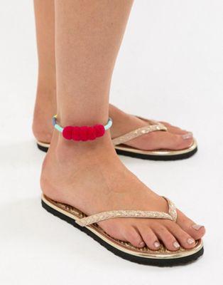 Image 1 sur ASOS DESIGN - Bracelet de cheville à pompons