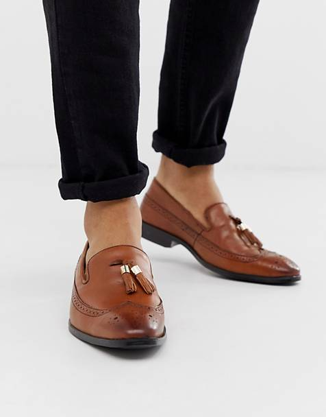 ASOS DESIGN brogue loafers in tan leather with gold tassel detail