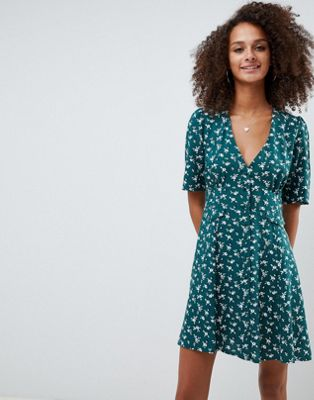ASOS DESIGN button through mini skater dress with pockets in floral print