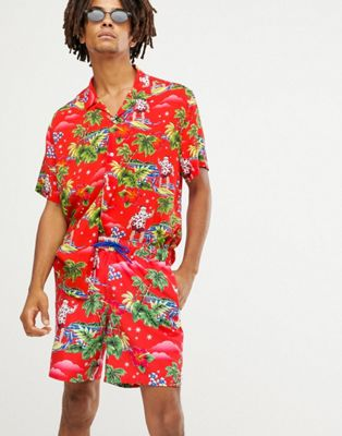 ASOS DESIGN Christmas swim shorts with surfing santa print in mid length