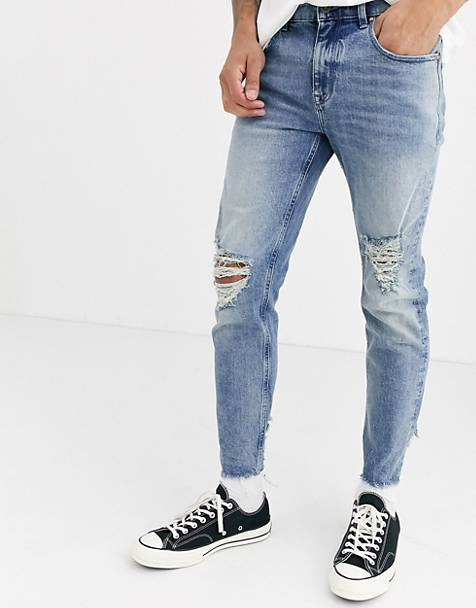 ASOS DESIGN Cone Mill Denim skinny 'American classic' jeans in vintage light wash with rips and raw hem