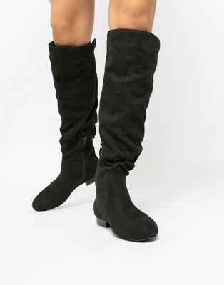 ASOS DESIGN - Connie - Stivali al ginocchio in montone sintetico