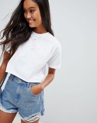 ASOS DESIGN crop t-shirt with roll sleeve and raw hem in white