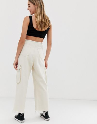 ASOS DESIGN Cropped wide leg jeans with utility pocket detail with raw wasitband in off white