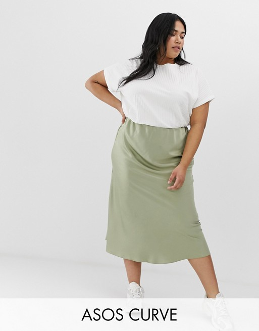 Image 1 of ASOS DESIGN Curve bias cut satin slip midi skirt