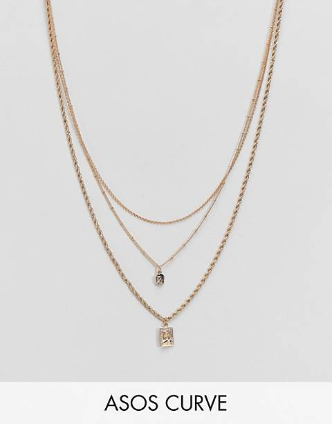 ASOS DESIGN Curve multirow necklace with vintage style icon pendants and mixed chains in gold