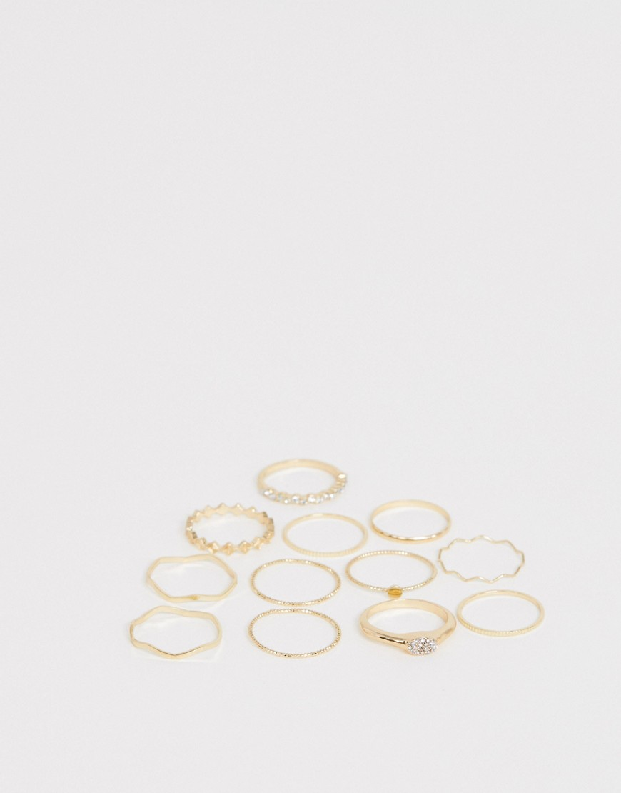 Asos Design Curve Pack Of 12 Rings In Mixed Design With Wavey And Engraved Rings In Gold by Asos Design