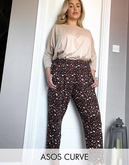 ASOS DESIGN Curve - Pantalon carotte en jersey à imprimé animal Pantalons et leggings femme