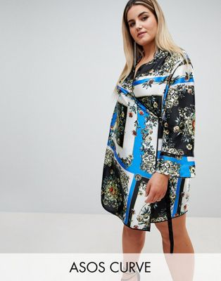 ASOS DESIGN Curve scarf print wrap mini dress with long sleeves and piping