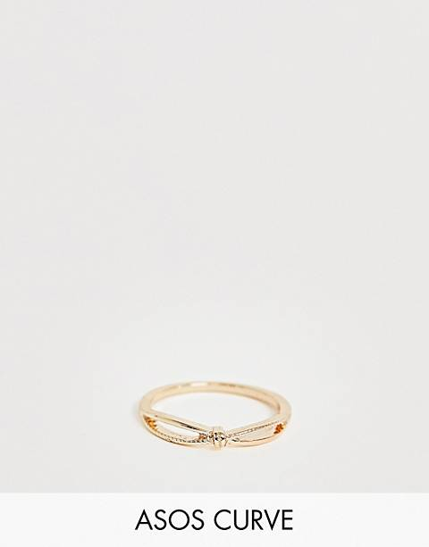 ASOS DESIGN Curve thumb ring in knotted cross twist design in gold