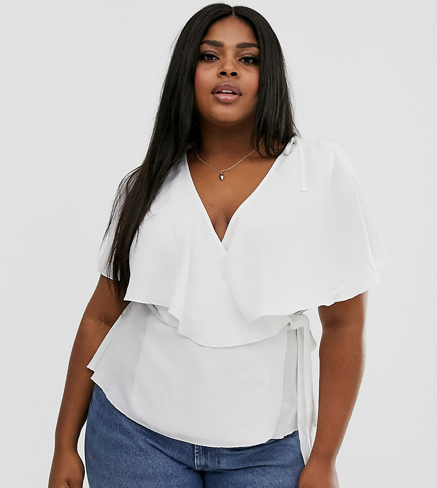 Plus-size top by ASOS DESIGN Add it to your everyday line-up V-neck Ruffle trim Tie side Cape overlay to reverse Slits to sleeves Regular fit Just take your usual size