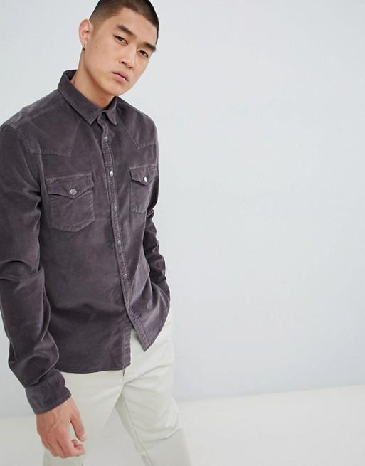 ASOS DESIGN – Czarna elastyczna sztruksowa koszula o dopasowanym kroju w stylu westernowym z zatrzaskami i efektem sprania