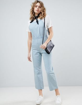 ASOS DESIGN denim cross back jumpsuit in midwash blue