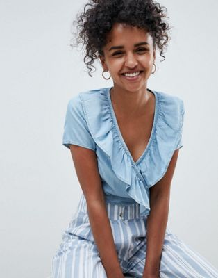 ASOS DESIGN denim wrap top with frill in tencel