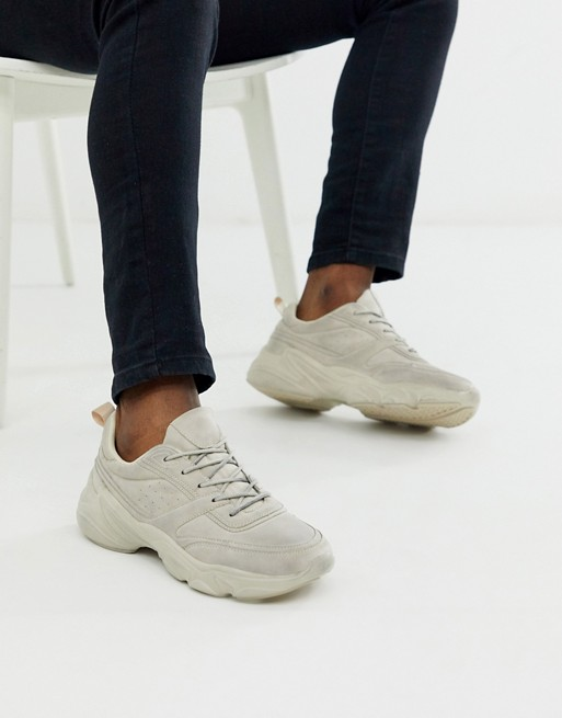 ASOS DESIGN distressed trainers in faux leather