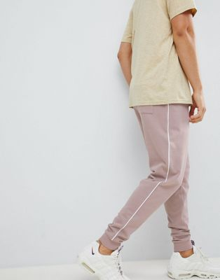 ASOS DESIGN drop crotch joggers with side piping