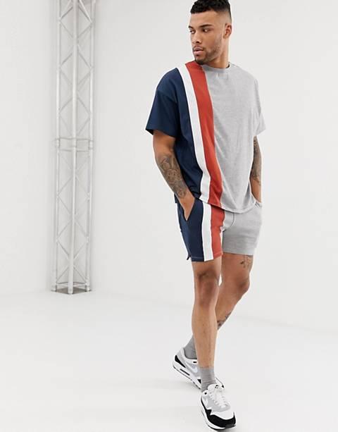 ASOS DESIGN – Enge, kürzer geschnittene Shorts mit Farbblockdesign in Grau, Kombiteil