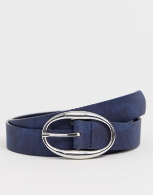 ASOS DESIGN faux leather slim belt in navy with silver oval buckle