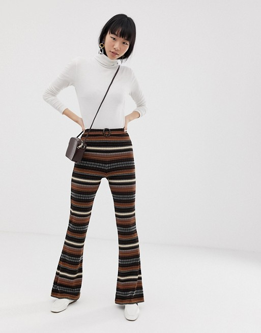 Image 1 of ASOS DESIGN flare trousers in stripe jacquard with tortoiseshell buckle detail