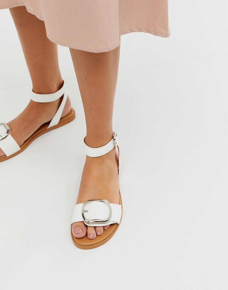 Sandals by ASOS DESIGN Sweet looks from the ground up Ankle-strap fastening Buckle detail Open toe Flat sole
