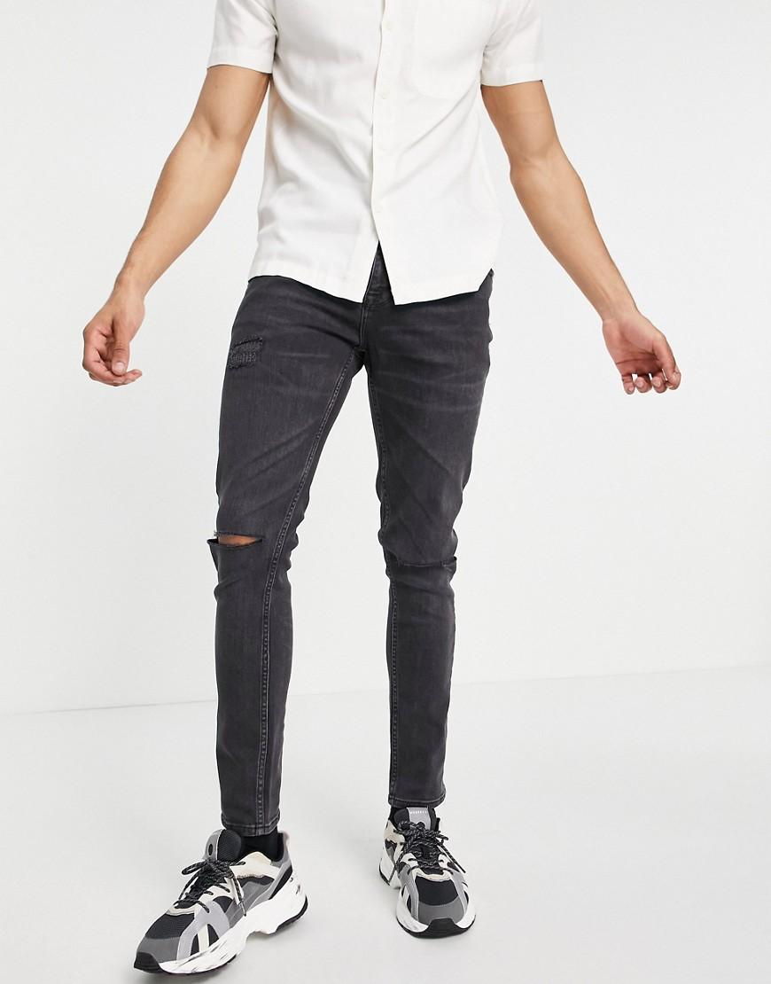 ASOS DESIGN - Forvaskede sorte skinny-jeans med knæ-flænger