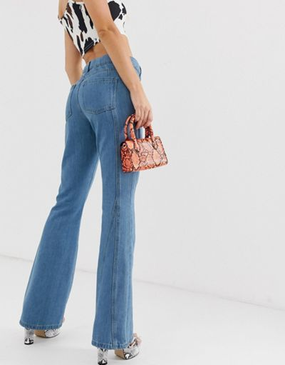 ASOS DESIGN Full length flare jeans with wrap waist band and cut about seam detail in mid green blue wash