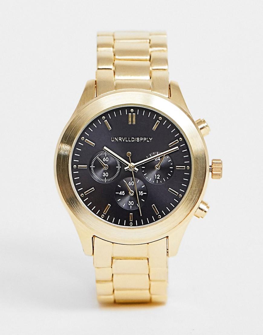 ASOS DESIGN – Goldfarbige Armbanduhr mit schwarzem Zifferblatt | Uhren | ASOS DESIGN