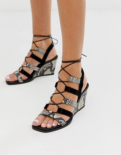 ASOS DESIGN Hansel suede mix mid heeled wedges in snake and black