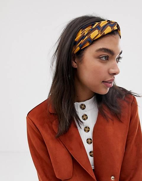 ASOS DESIGN headband with oversized twist front in geo monogram print