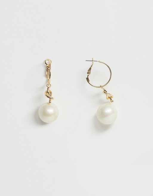 Image 1 of ASOS DESIGN hoop earrings with knot and pearl drop in gold tone