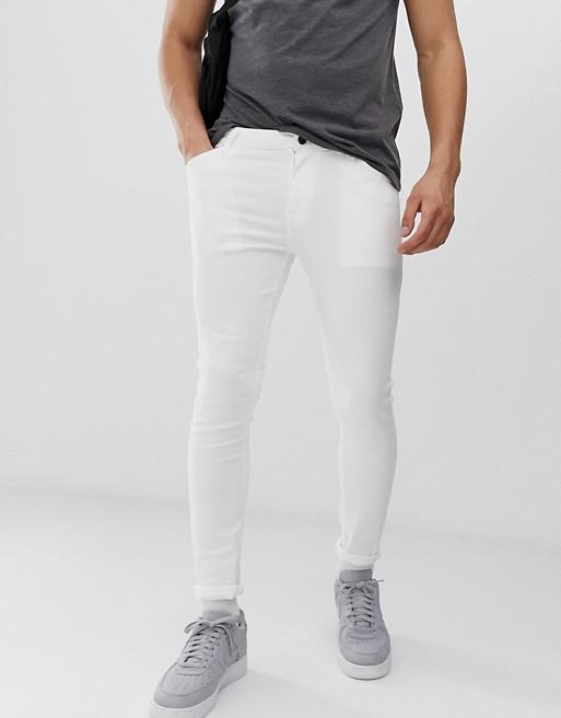 Image 1 sur ASOS DESIGN - Jean seconde peau en tissu power stretch - Blanc