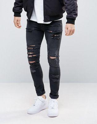 ASOS DESIGN - Jeans super skinny da 12,5 once con strappi grandi nero slavato
