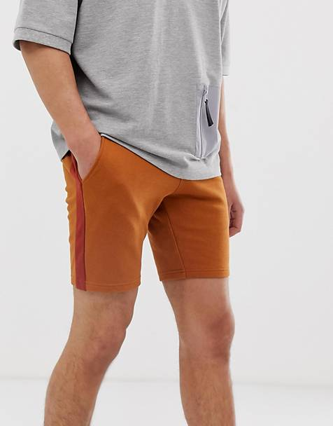 15e3a5d89e0 ASOS DESIGN jersey skinny shorts with side stripe in dark orange