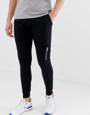 Immagine 1 di ASOS DESIGN - Joggers skinny con tasca MA1 neri