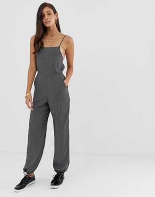 ASOS DESIGN jumpsuit with strappy back and elasticated cuffs in spot
