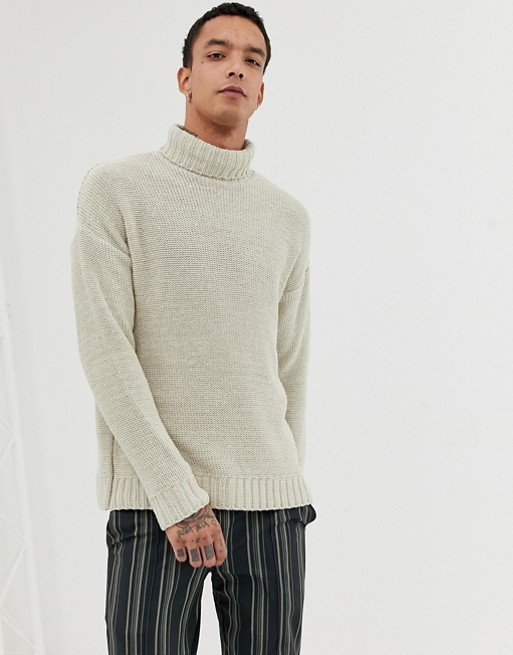 ASOS DESIGN knitted oversized roll neck sweater in beige