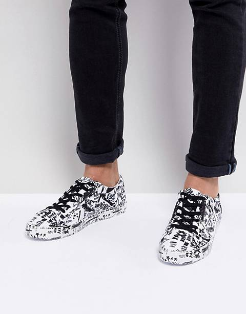 ASOS DESIGN lace up sneakers with graffiti print