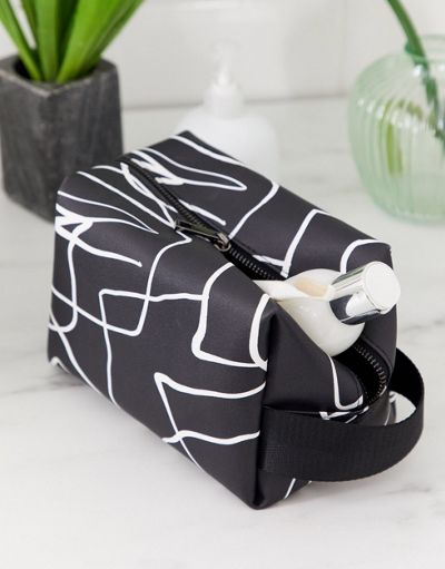 ASOS DESIGN large wash bag in abstract print
