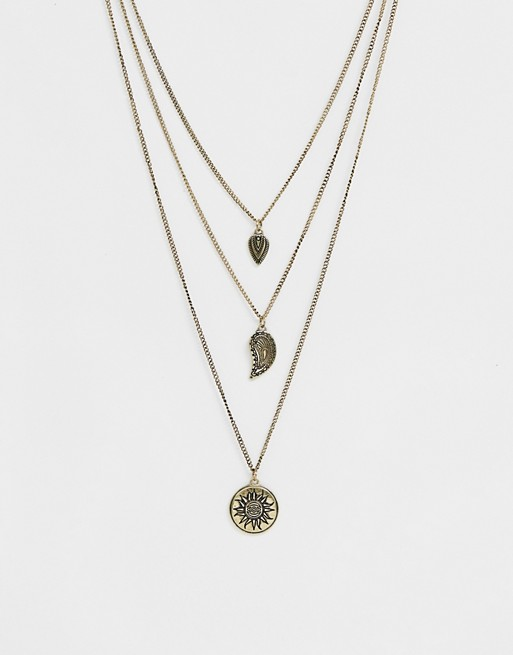 ASOS DESIGN layered necklace with sun charm in burnished gold tone