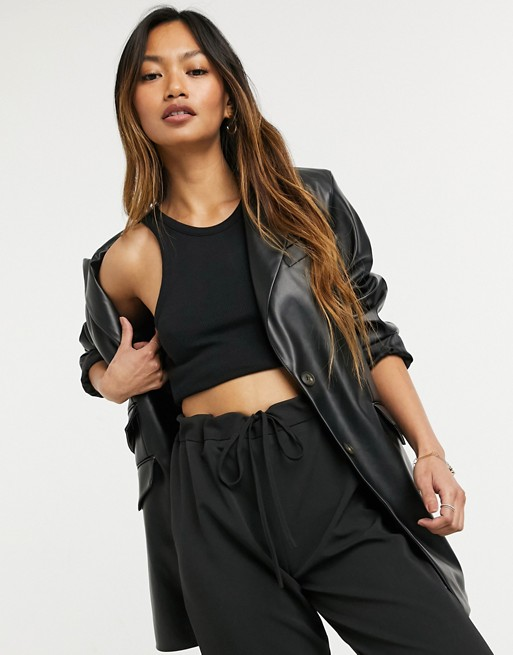 ASOS DESIGN leather look strong shoulder nipped waist longline blazer in black