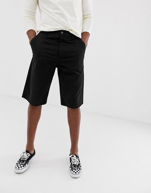 Bild 1 von ASOS DESIGN – Legere längere Chino-Shorts in Schwarz